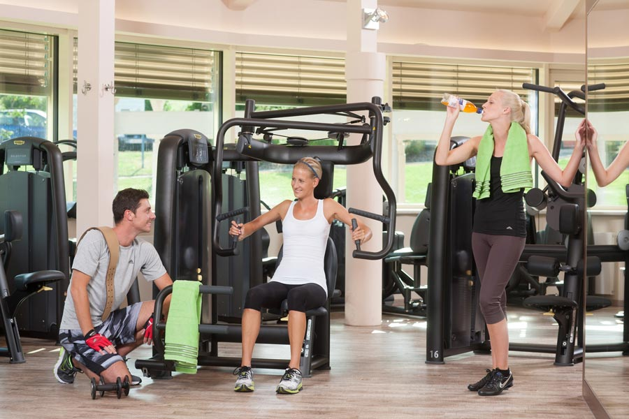 People work out in fitness center in the AVITA Resort